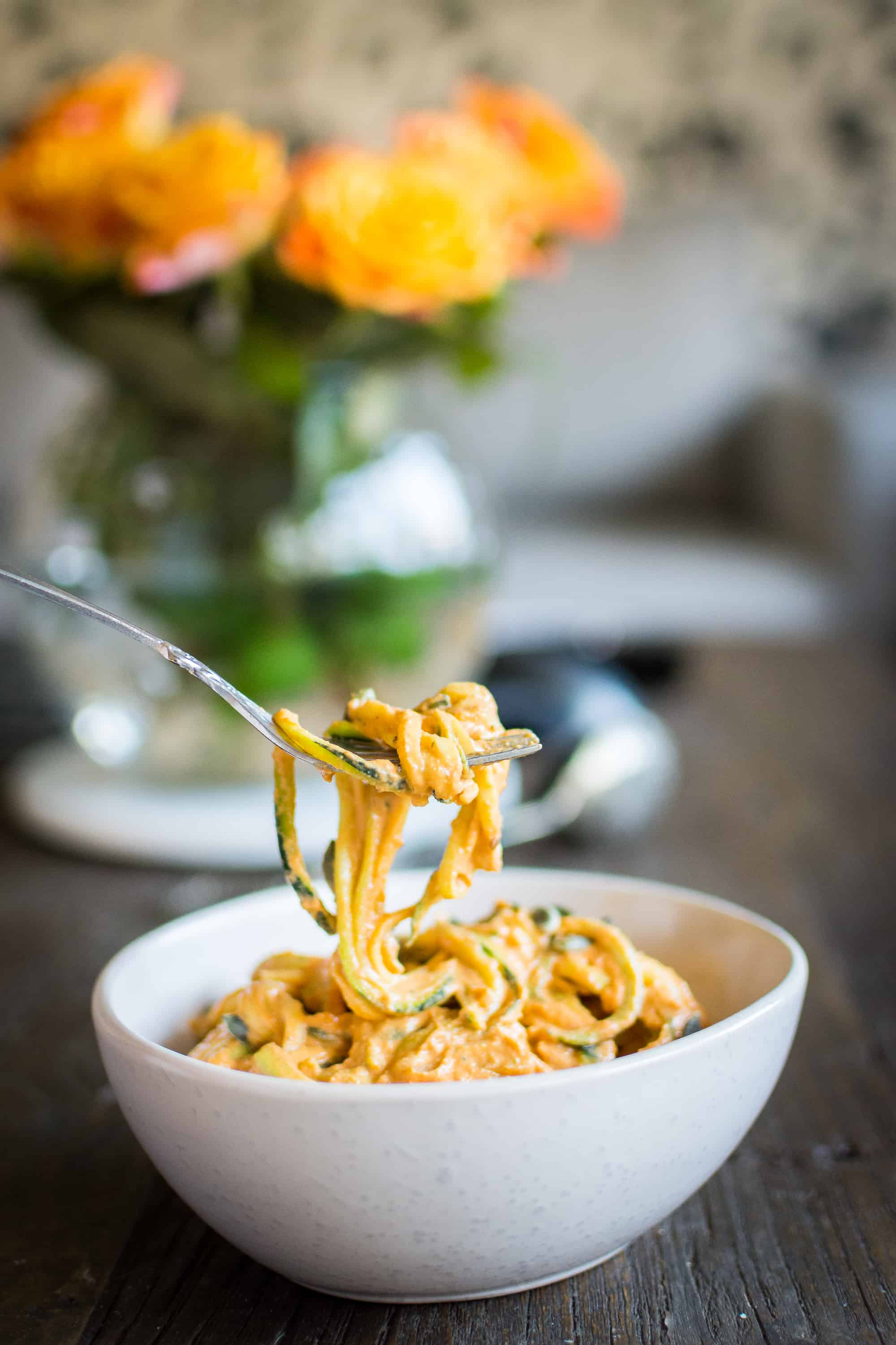 Zucchini pasta with creamy cashew bell pepper sauce, a dish that is perfect on a warm summer day like this. It is easy and quick to prepare, and it's not too heavy. If you don't like zucchini pasta you can substitute with wheat spaghetti or other pasta. To make zucchini noodles you'll need a tool called spiralizer. You can buy a handheld spiralizer<a target=